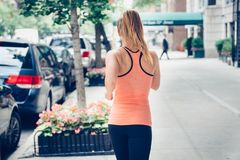 Woman running on New York City street at the morning. Stock Photo