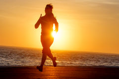 Woman running with ocean view royalty free stock photography