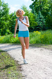 Woman running outdoor in a park Royalty Free Stock Photos