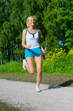 Woman running outdoor in a park Stock Photo