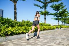 Woman running at outdoor park Stock Photos