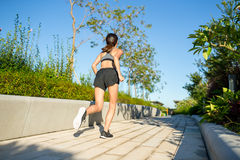Woman running at outdoor Royalty Free Stock Photos