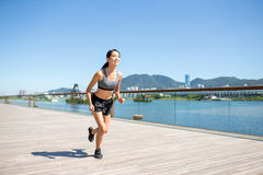 Woman running at outdoor Stock Images