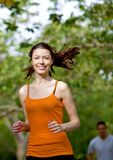Woman running outdoors Stock Photography