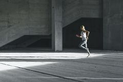 Woman running outdoors in the city, urban style. Woman running outdoors in the city, urban city, in the morning Stock Images