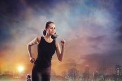 Woman running outdoors in a city Royalty Free Stock Images