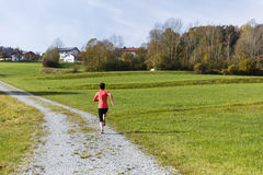 Woman running outdoors in the countryside of Bavarain National Stock Photography