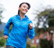 Woman running outdoors Royalty Free Stock Photo