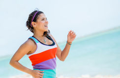 Woman running outdoors Stock Photos