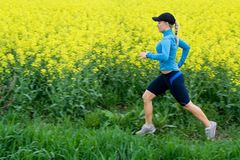 Woman running outdoors, motion blur Royalty Free Stock Photo
