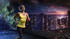 Woman running outdoors on the night town Stock Images