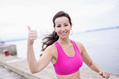 Woman running outdoors training for marathon run Royalty Free Stock Photography
