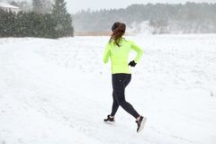 Woman running outdoors in winter Royalty Free Stock Image