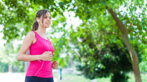 Woman running outdoors Royalty Free Stock Images
