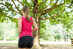 Woman running outdoors Stock Image