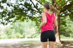 Woman running outdoors Stock Photos