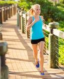 Woman running outside along path Stock Photography