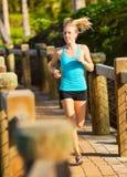 Woman running outside along path Stock Photos