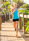 Woman running outside along path Royalty Free Stock Photo