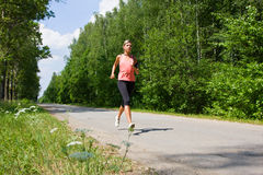 Woman running in the park. Stock Photos