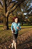 Woman running through park Royalty Free Stock Photo