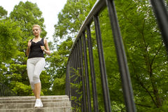 Woman running in park Royalty Free Stock Photography