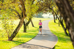 Woman running in the park Royalty Free Stock Photography