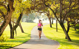 Woman running in the park Royalty Free Stock Photo