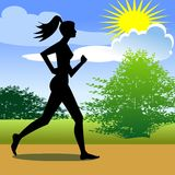 Woman Running in the Park. Women running in the park, with the sky in the background Royalty Free Stock Photos