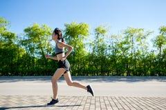 Woman running at park Stock Photography