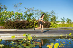 Woman running in a park Stock Photos