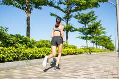 Woman running in a park Stock Photo