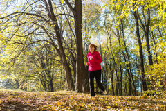Woman running in park Stock Photography