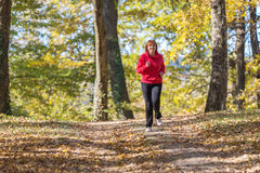 Woman running in park Royalty Free Stock Images