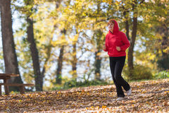 Woman running in park Royalty Free Stock Photo