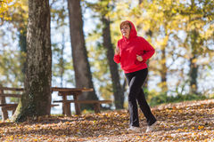 Woman running in park Royalty Free Stock Photos