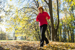 Woman running in park Stock Images