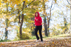 Woman running in park Royalty Free Stock Image
