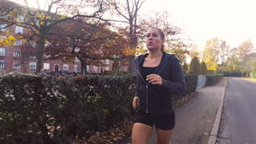 Woman Running in Park in the Autumn Stock Photos