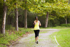 Woman running at the park Stock Images