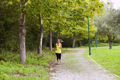 Woman running at the park Royalty Free Stock Photo