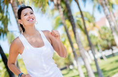 Woman running park Stock Photography