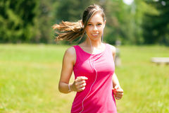 Woman running at the park Royalty Free Stock Images