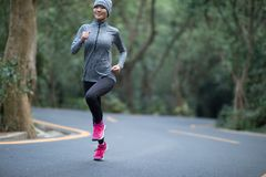 Woman running at park road royalty free stock images