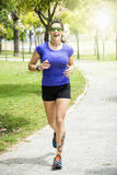 Woman running in the park Stock Image
