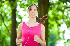 Woman running at the park stock image