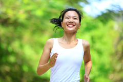 Woman running at park Royalty Free Stock Images
