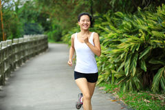 Woman running at park Stock Photography