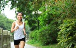 Woman running at park Royalty Free Stock Photos