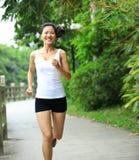 Woman running at park stock photo